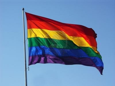 263334-big-rainbow-flag-in-blue-sky