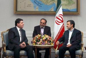 Iranian President Mahmoud Ahmadinejad (R) meets with Syrian Prime Minister Wael al-Halqi (L) in Tehran, Iran, Jan. 15, 2013. Ahmadinejad called on Tuesday for enhancing relations with Syria in different fields. (Xinhua/Ahmad Halabisaz)