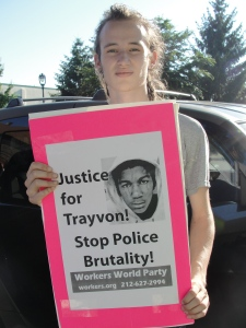 """Tommy Cavanaugh of Rockford, IL participates in """"Justice For Trayvon Martin"""" protest in Milwaukee July 14, 2013."""