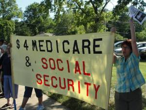 At a protest against the Americans For Prosperity (Austerity) in Topeka, Kansas July 10, 2013.
