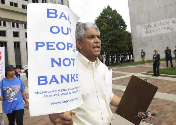 Walter Knall, 70, of Detroit, a 31-year employee of the Detroit Health Dept., protests July 26 in front of City Hall. (Clarence Tabb, Jr./The Detroit News)