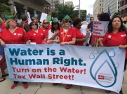 Members of the National Nurses United march in Detroit July 18, 2014.