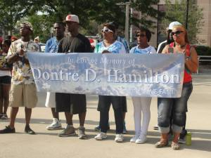 Hundreds rally at Red Arrow Park in Milwaukee August 22, 2014  to demand justice for Michael Brown, Dontre Hamilton & other Victims of police terror. [Photo: WI BOPM]