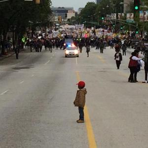Young Nigel waits for the rest of the #FergusonOctober marchers to catch up.