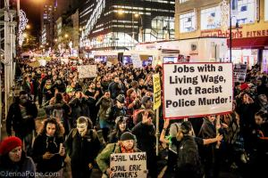 The day after a grand jury decided not to indict Darren Wilson in the murder of Mike Brown, thousands of protesters marched through Lower Manhattan, eventually taking over FDR Drive, a major roadway in NYC. [Photo: Jenna Pope]