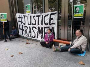 Activists lock themselves to the doors of a federal building in Oakland, CA November 12, 2014 to demand the immediate freedom of Rasmea Odeh.