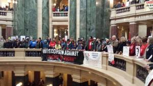 "Workers and Community members pack the rotunda at the state capitol in Madison, Feb. 25, 2015. The are demanding ""Shut Down RTW!"""