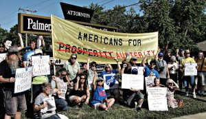 A diverse array of labor-community organizations including the Kansas AFL-CIO protest the right-wing and racist Americans For Prosperity (Austerity) in Topeka, Kansas July 2013.