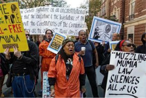 Pam Africa marching in Philly demanding justice for Mumia Abu-Jamal and all prisoners [Photo: Joe Piette]